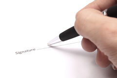 Signing contract. Close up of businessman signing a contract Royalty Free Stock Image