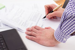 Signing a Contract. Businessman with fountain pen signing contract Royalty Free Stock Image