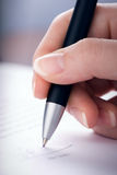 Signing of the contract. The woman signs the contract a ball pen Stock Photo