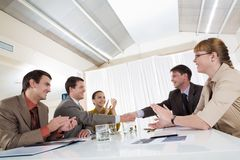 After signing contract. Image of happy business leaders handshaking at meeting Royalty Free Stock Photos