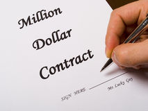 Signing a contract. Mr. Lucky Guy signing a million dollar contract with pen Stock Photo
