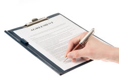Signing a contract (agreement) isolated Stock Photos