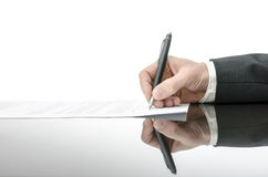 Signing a contract on a black table Stock Photos