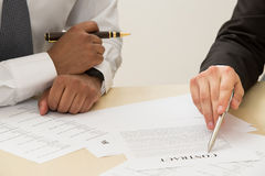Signing a contract. Business man signing a contract Stock Photo