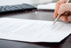 Signing Contract By Businessmen On The Table Royalty Free Stock Image