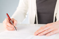Signing a contract or a document Stock Images