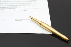 Signing contract with fountain pen.  Stock Images