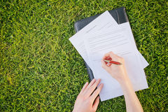 Signing Contract on a Grass Field Stock Images