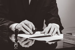 Signing contract. Lawyer or notar on his workplace Royalty Free Stock Photography