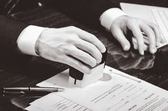 Signing contract. Lawyer or notar on his workplace Stock Image