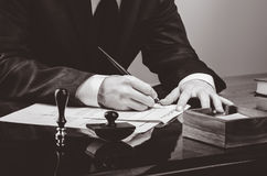Signing contract. Lawyer or notar on his workplace stock images