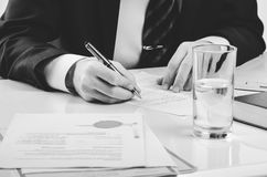 Signing contract. Lawyer or notar on his workplace Stock Photos