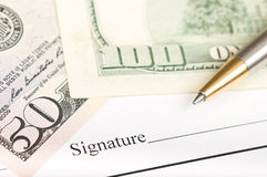 Signing on a contract Stock Photo