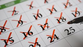 Signing a day on a calendar