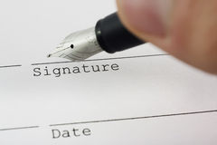 Signing the deal with fountain pen. Signing the deal with a fountain pen royalty free stock images
