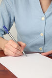 Signing a document Stock Photos