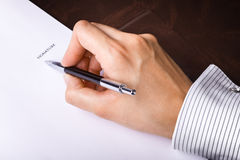 Signing a document Royalty Free Stock Images