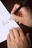 Signing a document Stock Photography
