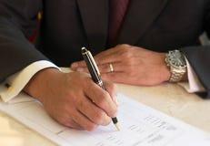 Signing document stock photo