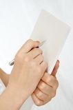 Signing the document. Hand of the woman signing the document royalty free stock images