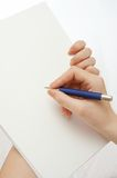 Signing the document. Hand of the woman signing the document royalty free stock photos