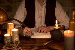 Signing a document, medieval theme Stock Photo