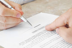Signing a Document Stock Images