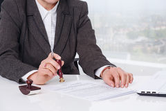 Signing document at office Royalty Free Stock Photo