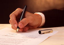 Signing a document Royalty Free Stock Photo