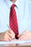 Signing documents Stock Photography