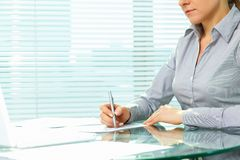 Signing documents. Business lady putting signatures on documents Stock Images