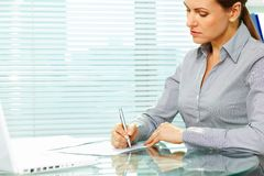 Signing documents. Business lady putting signatures on documents Royalty Free Stock Image