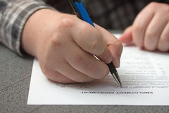 Signing a employment agreement Stock Photo
