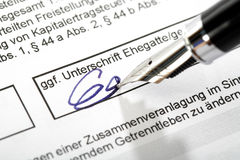 Signing an exemption order Stock Photos