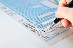 Signing a financial paper. Stock Photo