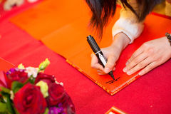 Signing on the guestbook in a wedding. Guests signing on the guestbook in a wedding stock photography