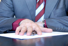 Signing hand Stock Photos