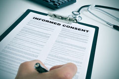 Signing an informed consent Royalty Free Stock Photos