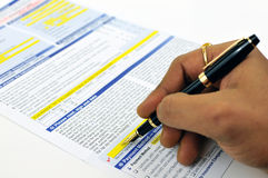 Signing insurance form Royalty Free Stock Image