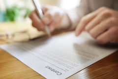 Signing legal contract document Stock Photos