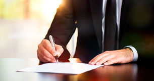 Signing Legal Document. Businessman Signing Legal Document Royalty Free Stock Photography