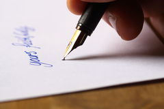 Signing a letter Royalty Free Stock Photography