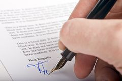 Signing letter Stock Images