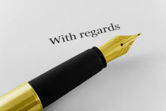 Signing the letter with fountain pen. Signing the letter with golden fountain pen Royalty Free Stock Images