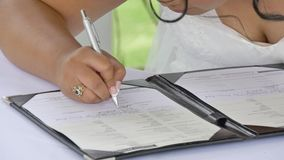 Signing of marriage register or guest book. Shot of signing of marriage register or guest book stock video