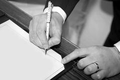 Signing marriage registration form Royalty Free Stock Image