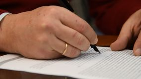 Signing a model release document stock footage