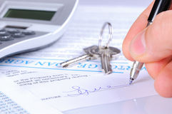Signing the mortgage contract to delivery of keys with calculato. R front view Royalty Free Stock Photography