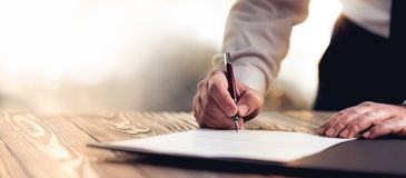 Signing Official Document. Businessman Signing An Official Document stock image