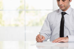 Signing Official Document. Businessman Signing An Official Document Royalty Free Stock Image